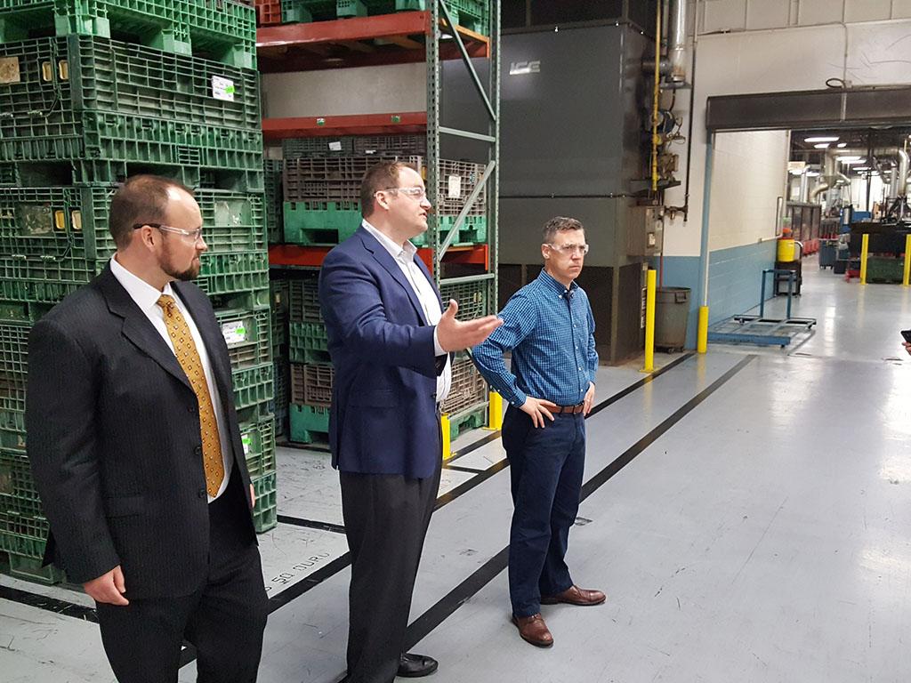 Congressman Jim Banks and Gary Jones discuss rail product inserts at Press-Seal