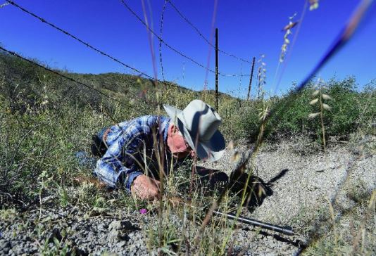 Cattle rancher Jim Chilton demonstrates how easy it is to cross the US-Mexico border on part of his 50,000 acre ranch southeast of Arivaca, Arizona (AFP Photo/Frederic J. Brown)