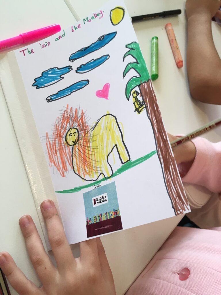 Student creating book during Maktaba school visit.
