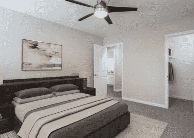 bedroom with carpet, ceiling fan, and closet