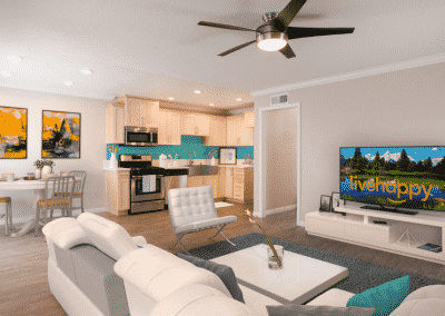 living room, kitchen, and dining area with furniture and decor