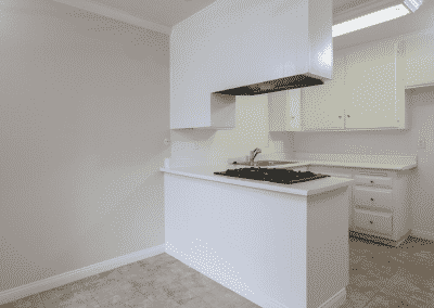 white kitchen counter and cabinets