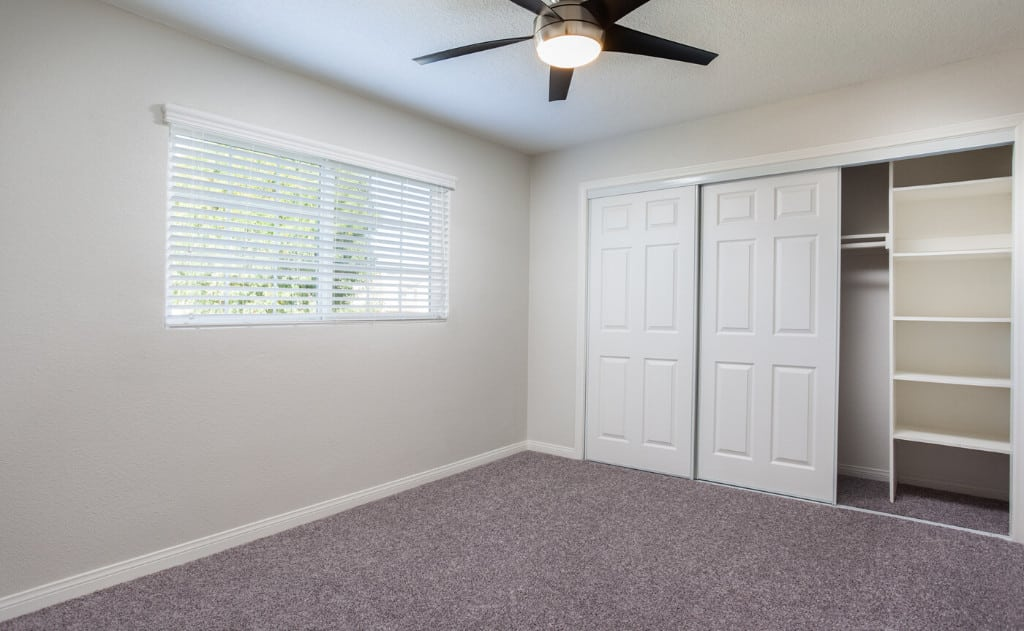 Bedroom with Ceiling Fan and Window