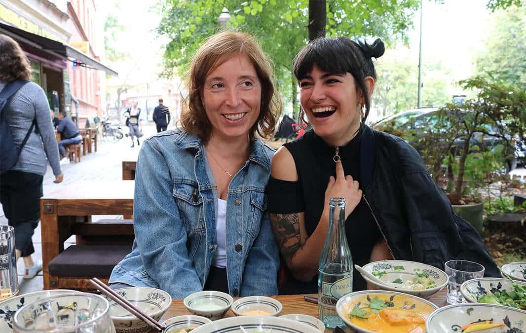 Two women eating outside the restaurant