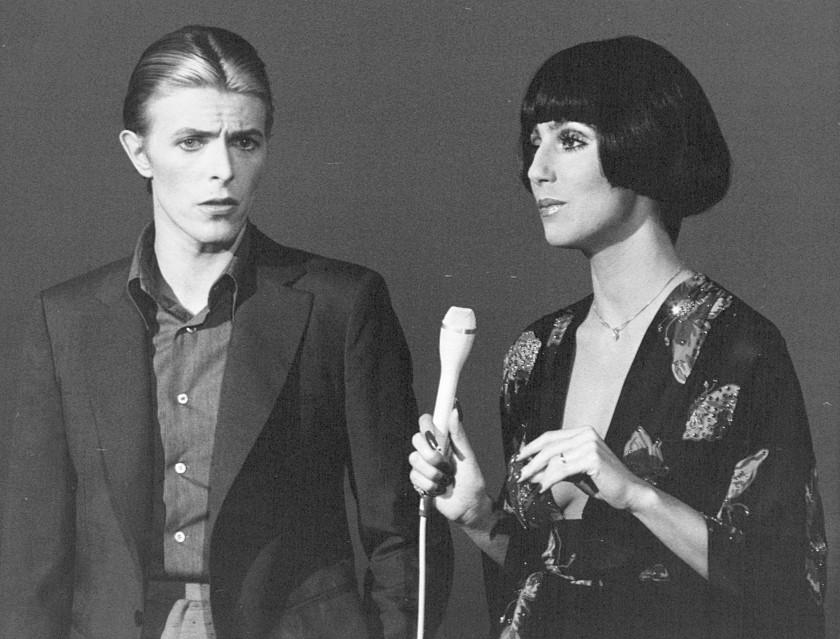 Bowie poses with Cher on the set of her TV show in 1975.