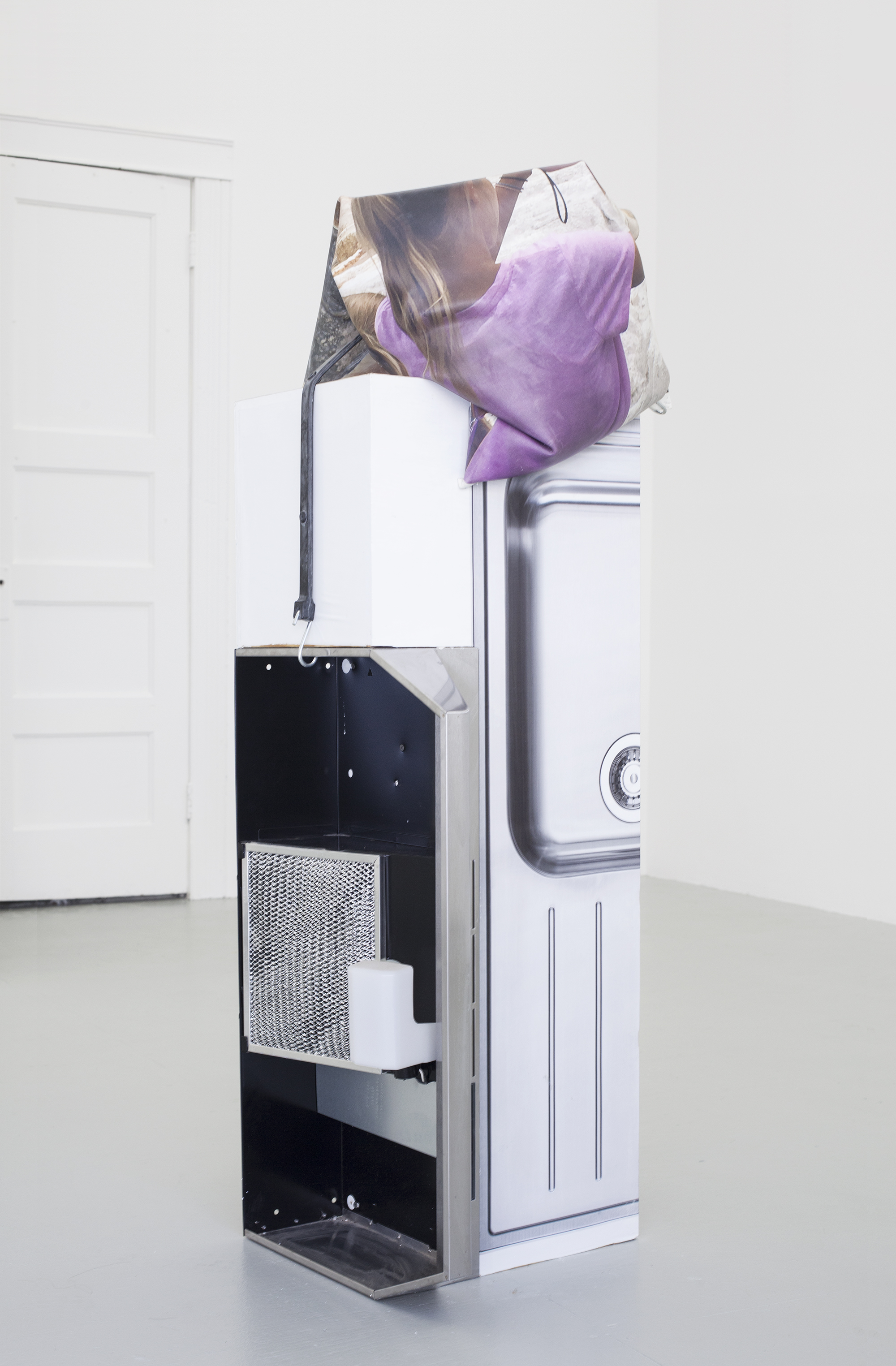 Ashley Carter Too Folds, 2015 Oven hood, vehicle wrap, plaster, digital print on silicone, and wood