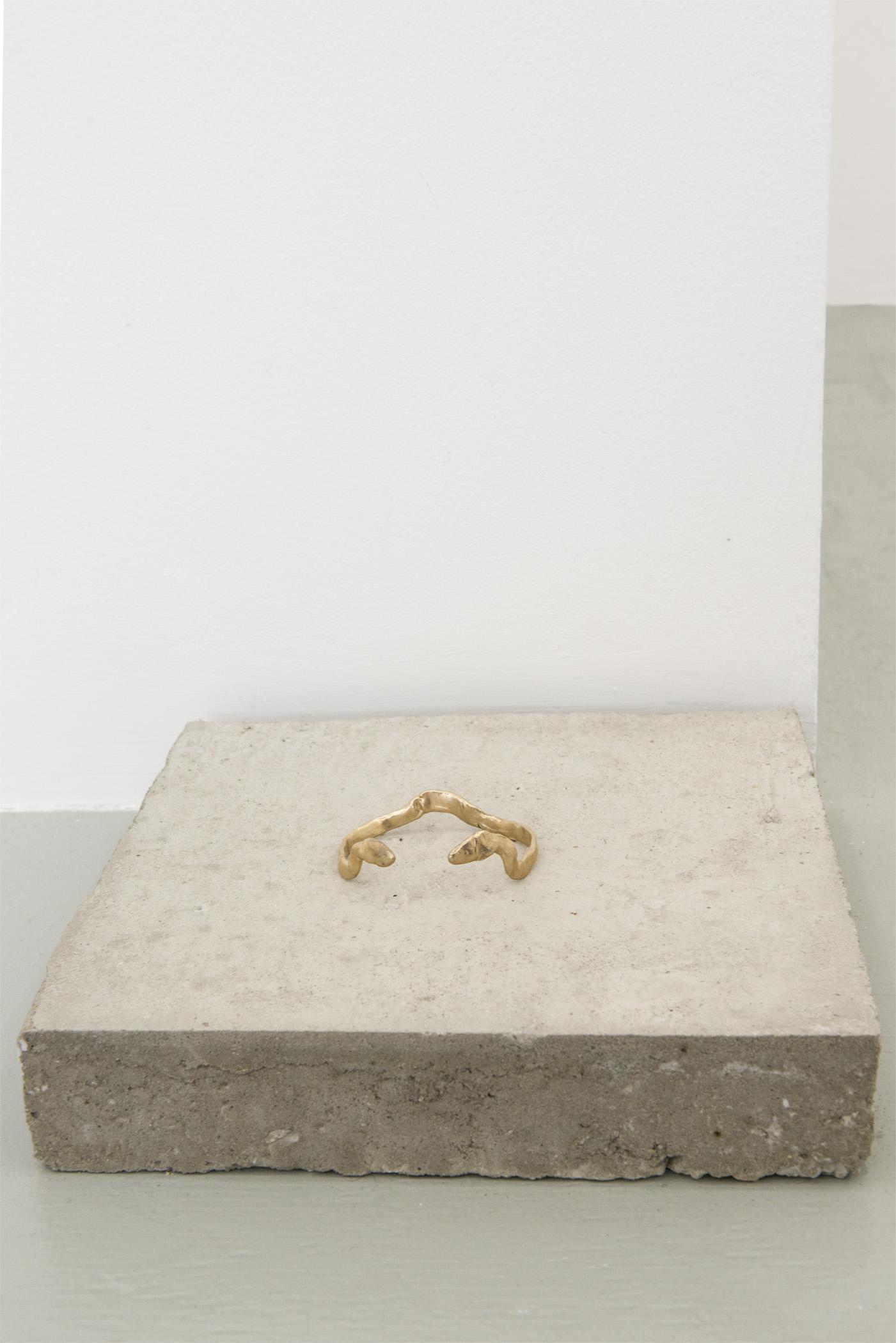Aidan Koch VII, Queen of Egypt, 2015 Cast bronze bracelet on cement block