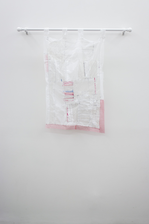 Athena Denos i feel a dark wind, 2014 Plastic bags, bubble wrap, thread, curtain rod