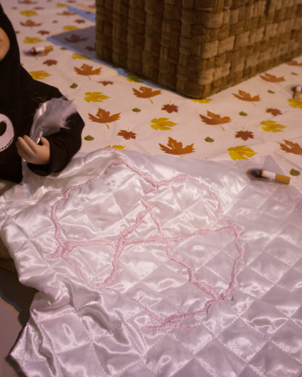 """Flannery Silva Chloé Doll (Detail), 2015 Amish Blessings """"Ruth"""" Doll, custom Jack Skelly sweatshirt, bloomers, sock, needle, hand embroidered anarchy heart quilt, fake cigarette burn"""
