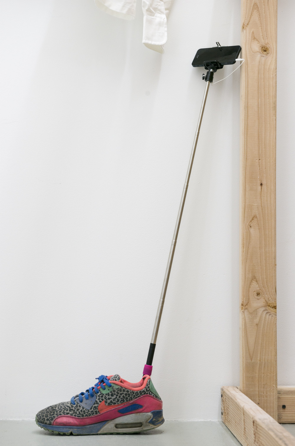 Yefu Liu Floating point (Detail), 2015 Single channel HD video, 9m24s, running shoe, selfie stick, iPhone