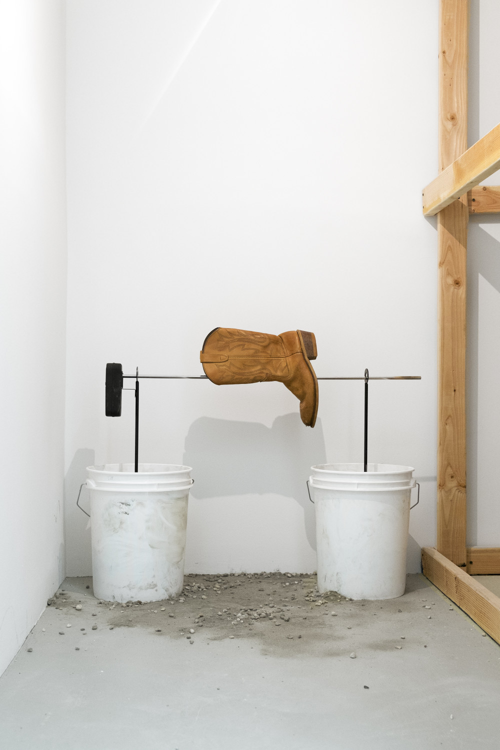 Quintessa Matranga Ask the Dust, 2016 Buckets, concrete, outdoor spit rotisserie, batteries, and leather boot. Dimensions variable