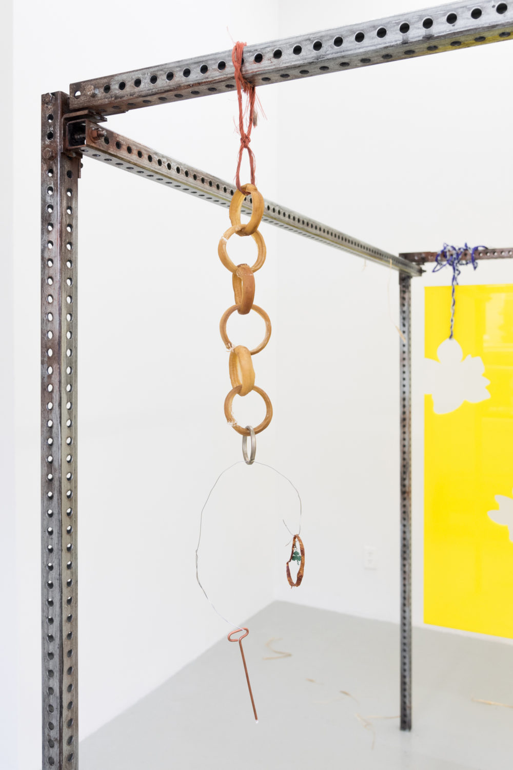 Gunnar Tchida Untitled, 2016 Rawhide, copper, sausage-casing ring, clover earring