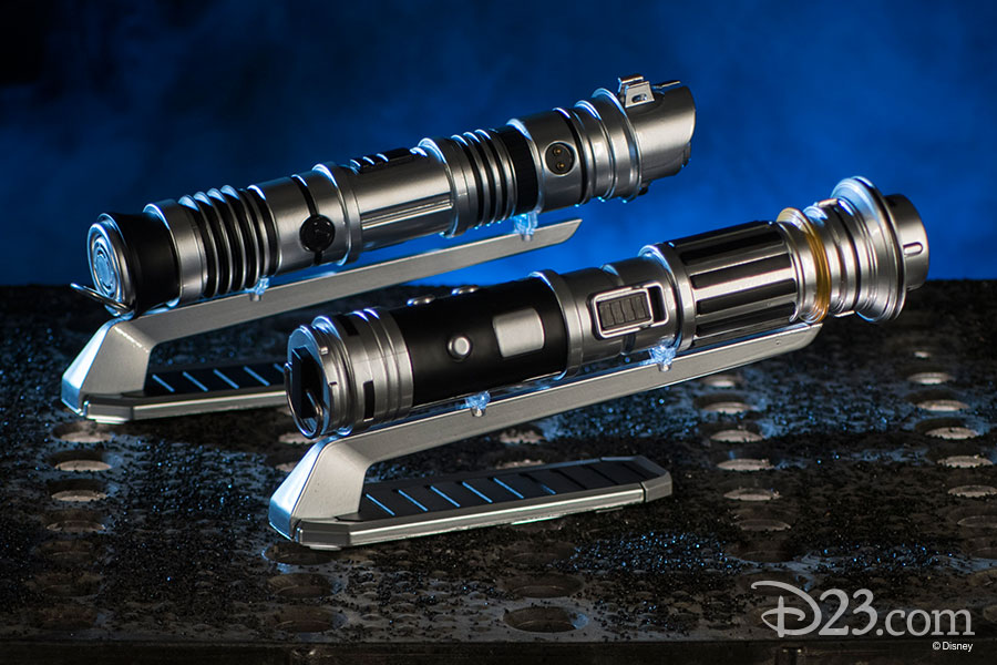 Two lightsaber hilts on stands.