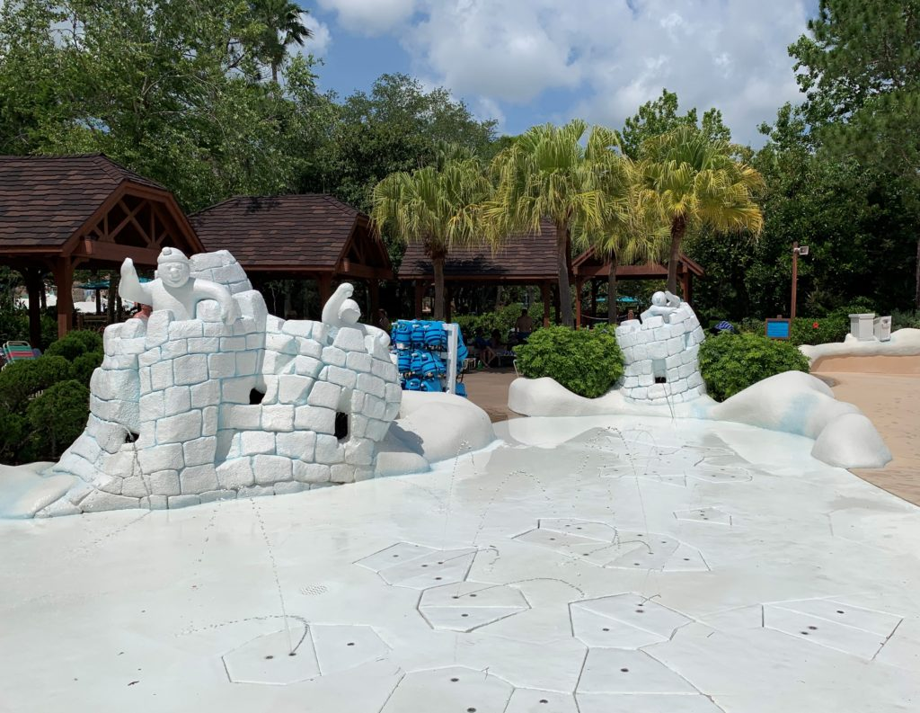 Some snowmen playing in their melting ice castles in Tike's Peak at Blizzard Beach.
