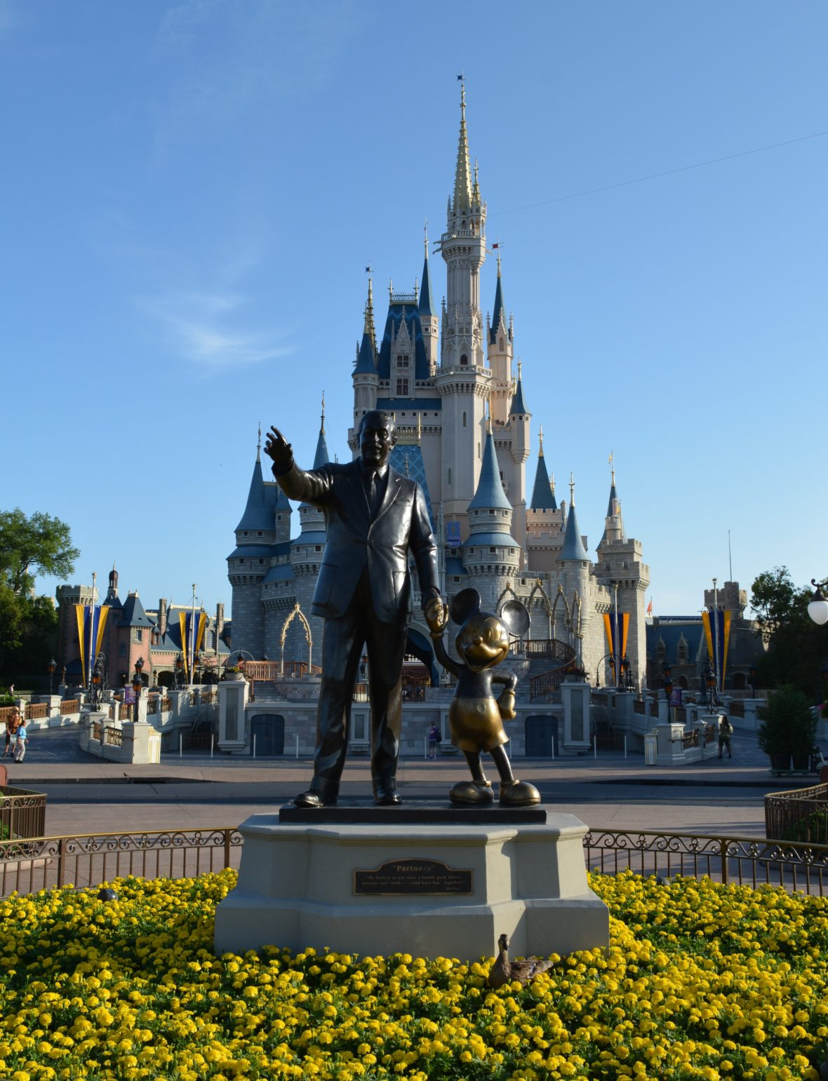 The Mickey and Walt Statue in front of Cinderella Castle in Walt Disney World