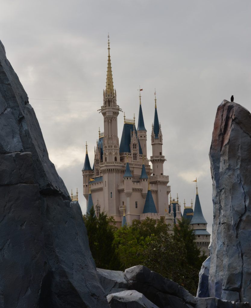 A picture of Cinderella Castle between the big boulders in Tomorrowland.
