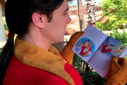 Meeting Gaston in Fantasyland in Magic Kingdom - Gaston With His Nose Stuck in a Book