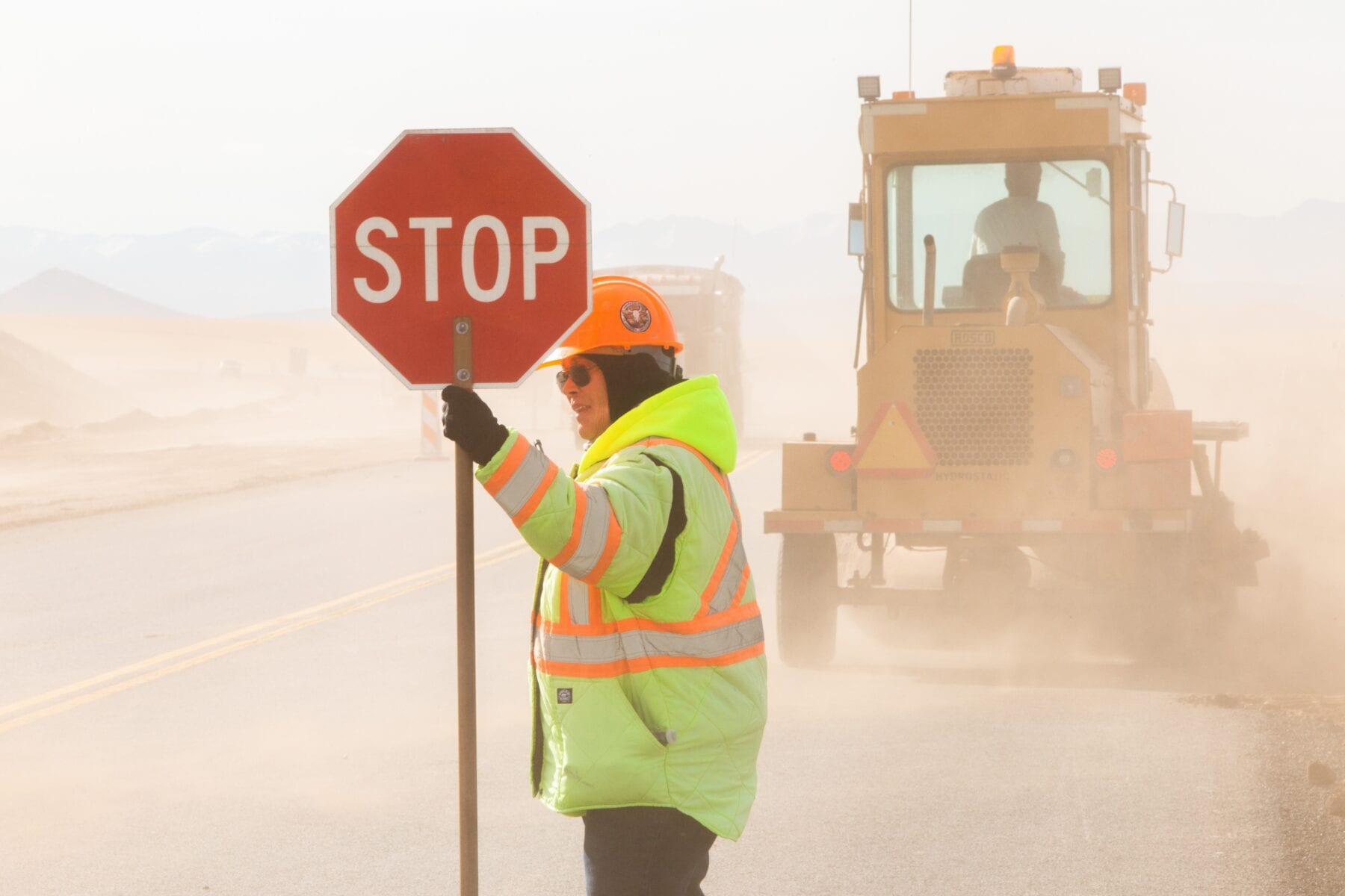 Practice safety in work zones and keep an eye out for construction workers guiding traffic