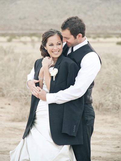 Groom wrap bride in jacket