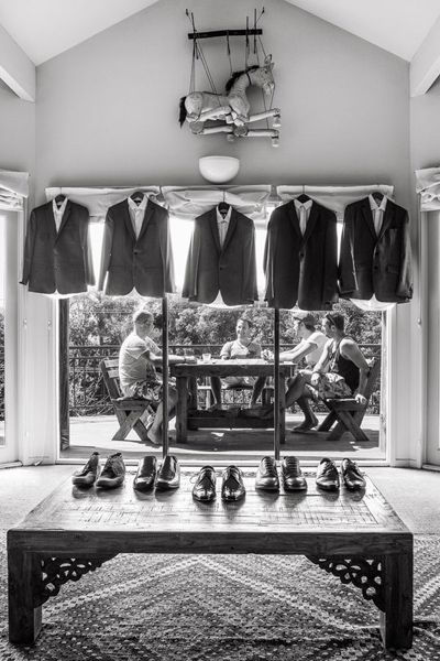 Groomsmen and Grooms suits hanging