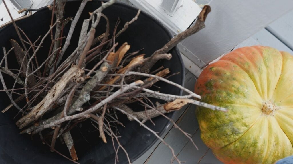 Fall Front Porch with pumpkins and kindling