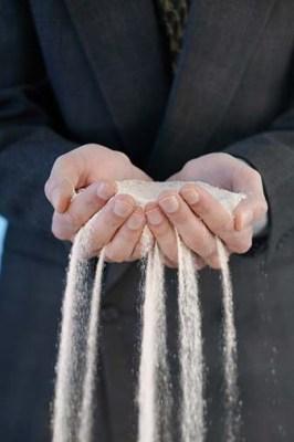 sand-through-fingers