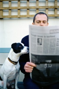 Man  and his dog reading newspaper