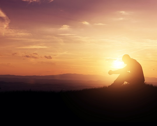 Praying at sunrise