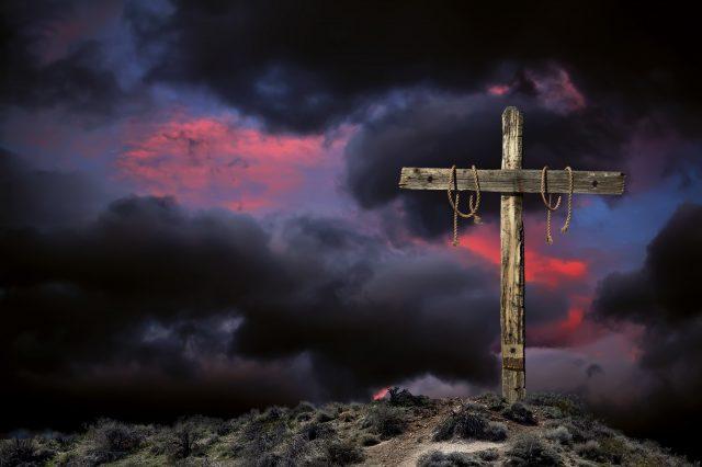 Empty Cross Against an Angry Sky