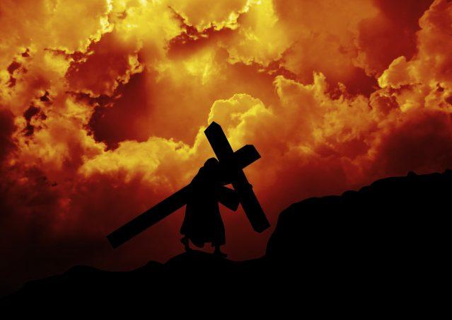 Jesus Christ carrying the cross up Calvary