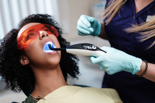 woman having her teeth whitened