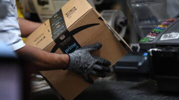 A worker assembles a box for delivery at the Amazon fulfillment center in Baltimore, Maryland, U.S.