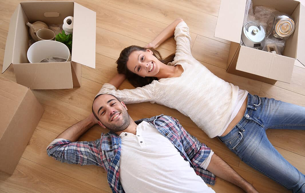 couple lying on floor of new home