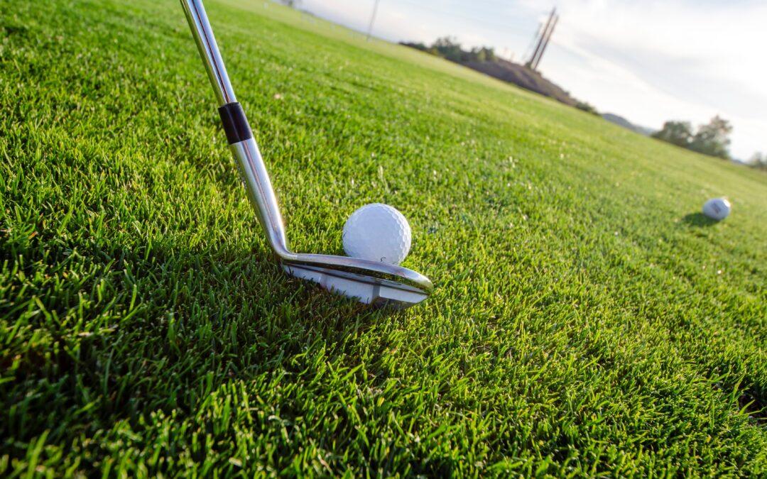 Golf balls at the green grass