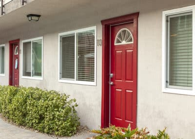 Red apartment door and exterior