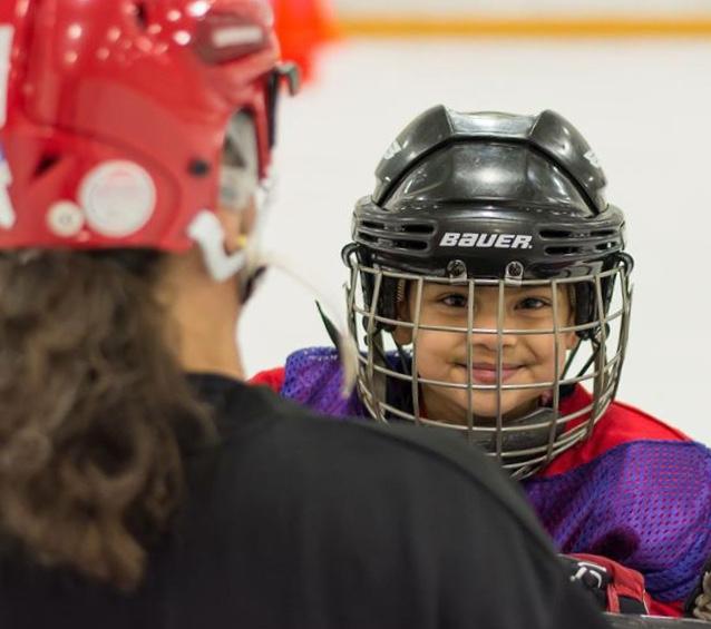 Dr. Kate coaching hockey