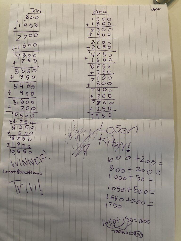 Score sheet using lined paper to keep numbers aligned based on place value.