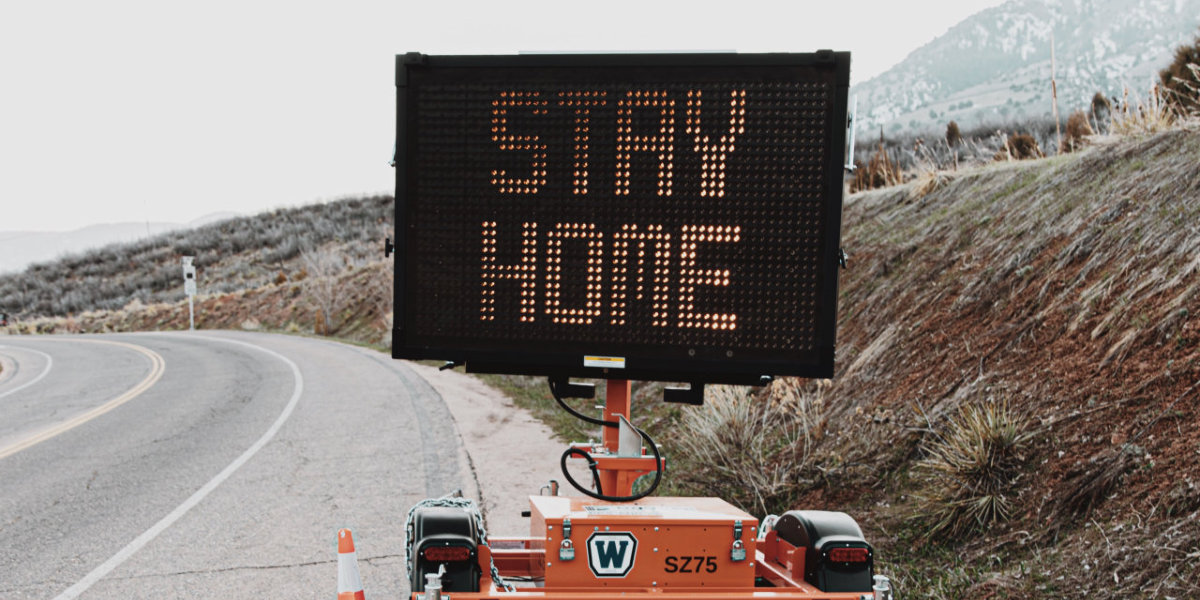 Road-side sign encouraging people to stay home during the coronavirus pandemic. Photo by LOGAN WEAVER on Unsplash.