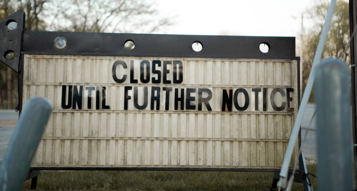 sign saying closed until further notices