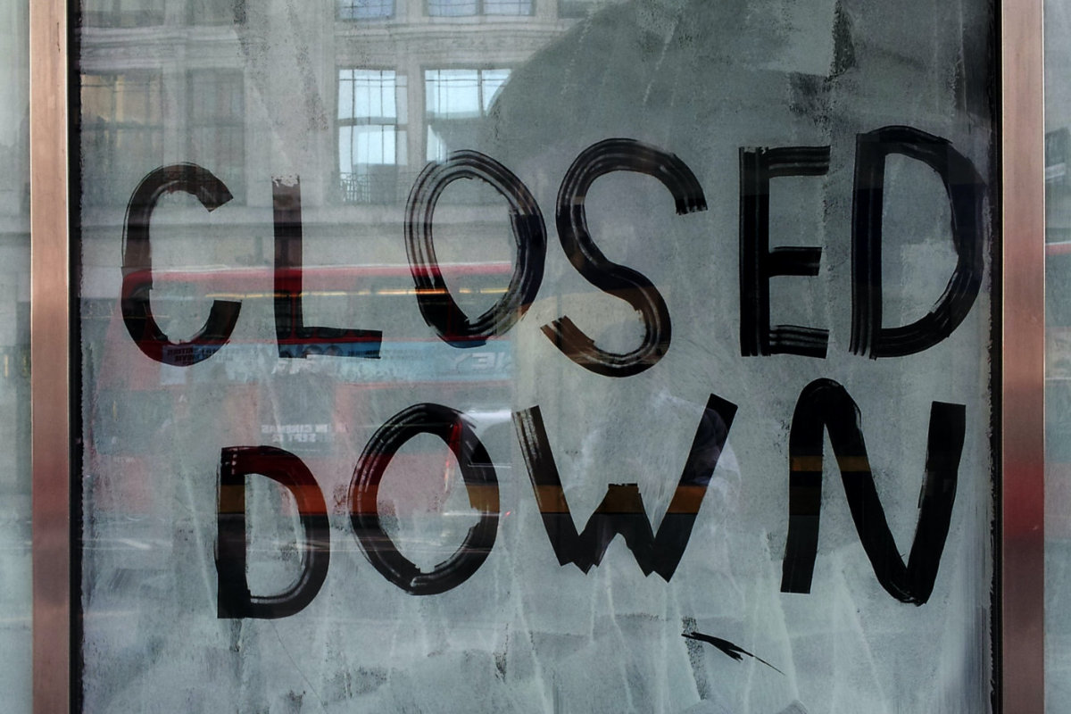 A closed store. Photo by Marco Bianchetti on Unsplash
