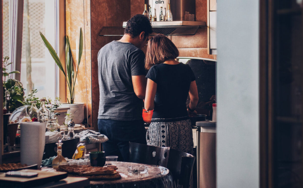 a couple cooking dinner