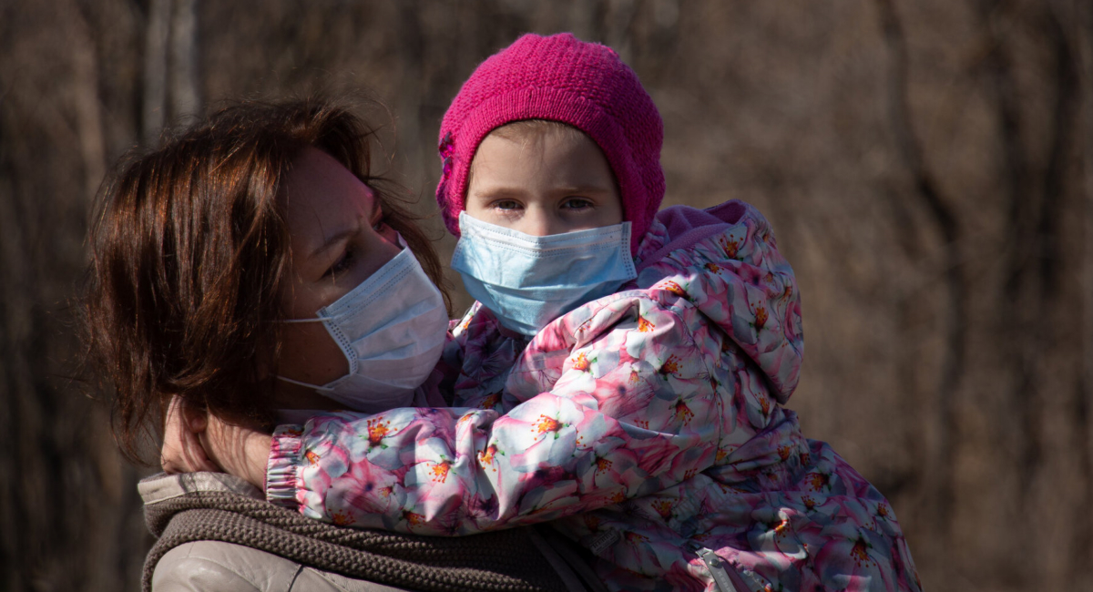 child and mom in facemasks