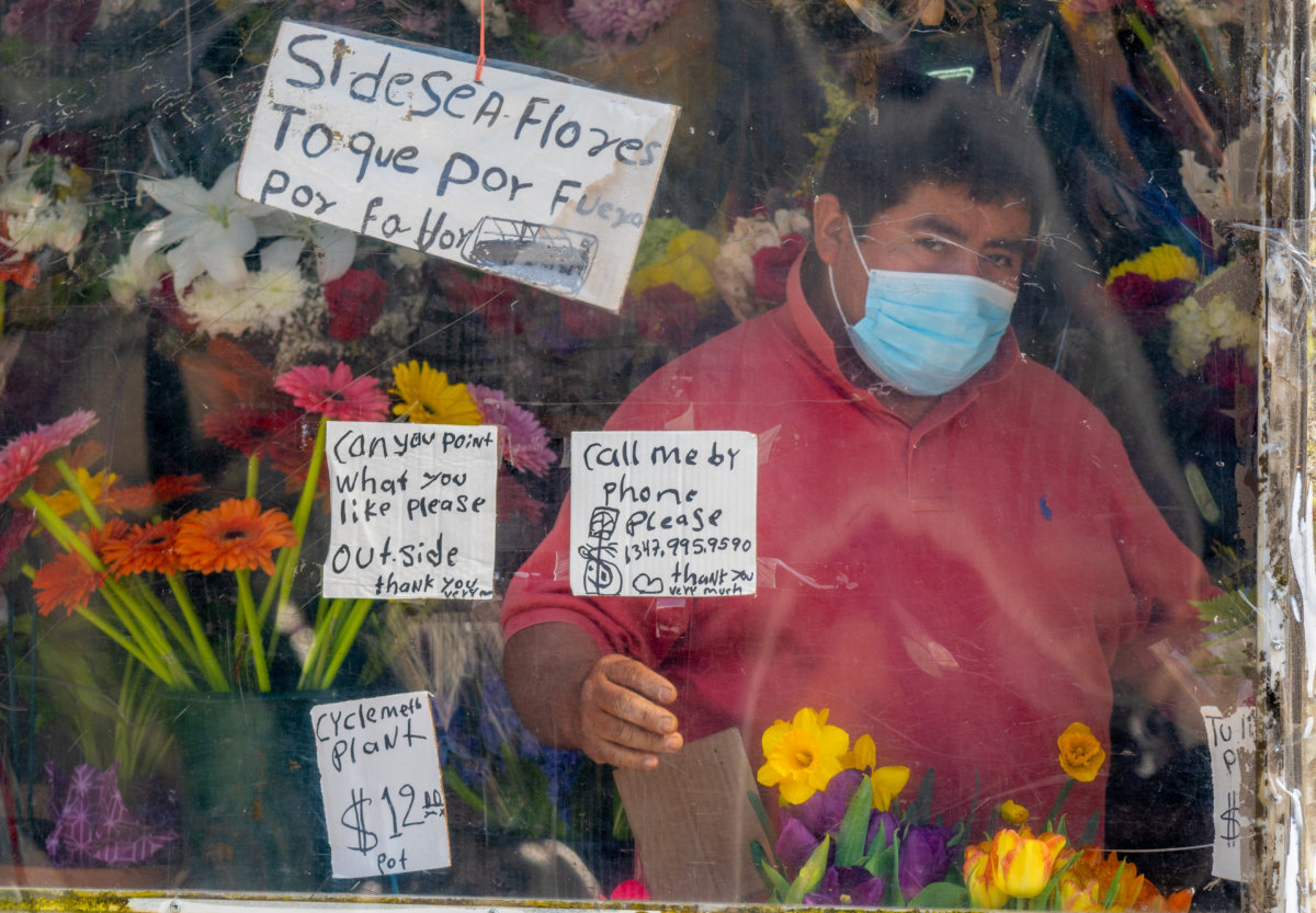 A florist in Brooklyn displays his wares. Photo by Julian Wan on Unsplash.