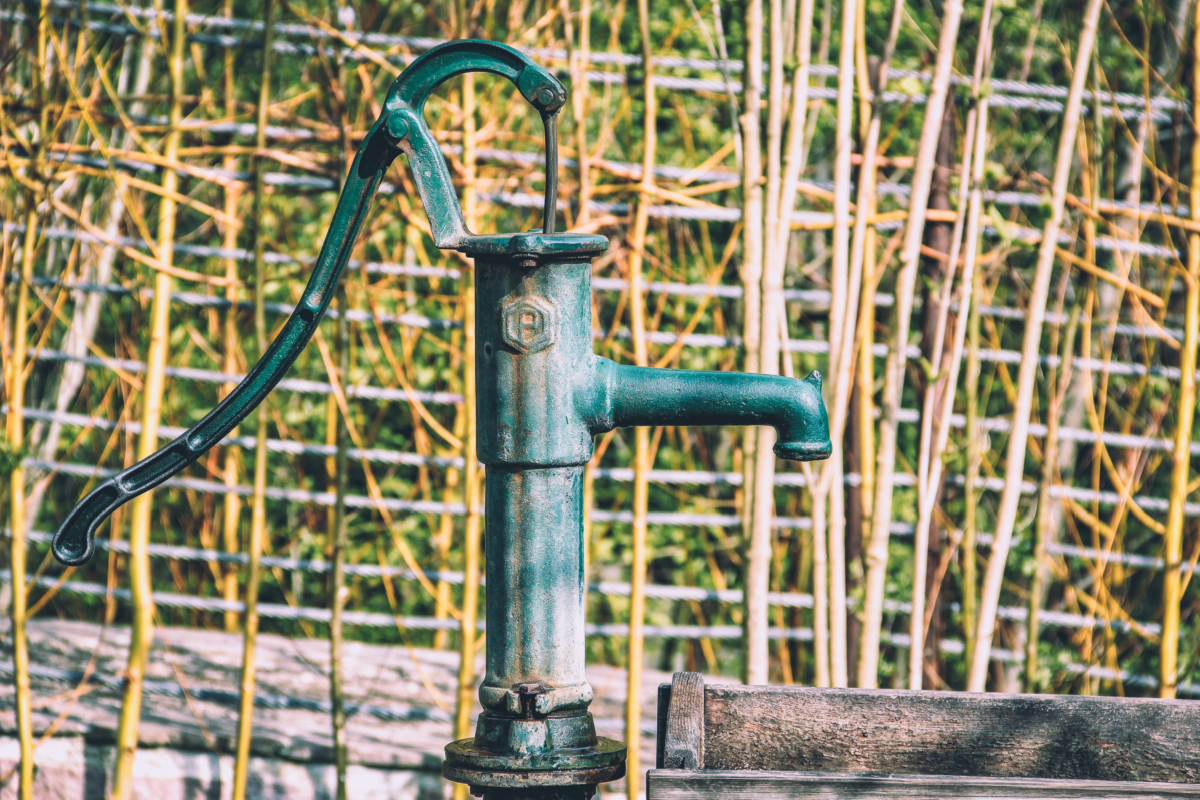 An old pitcher pump.Photo by Herbert Goetsch on Unsplash