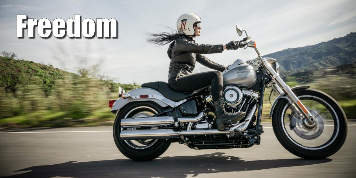 Woman riding a Harley-Davidson