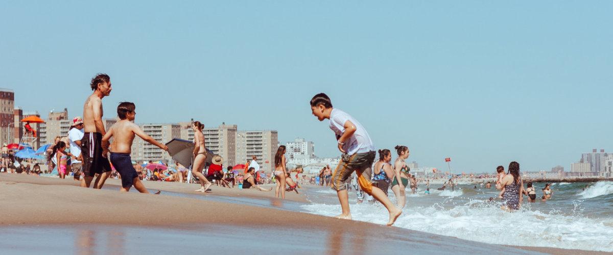 Kids play on a beach in Brooklyn