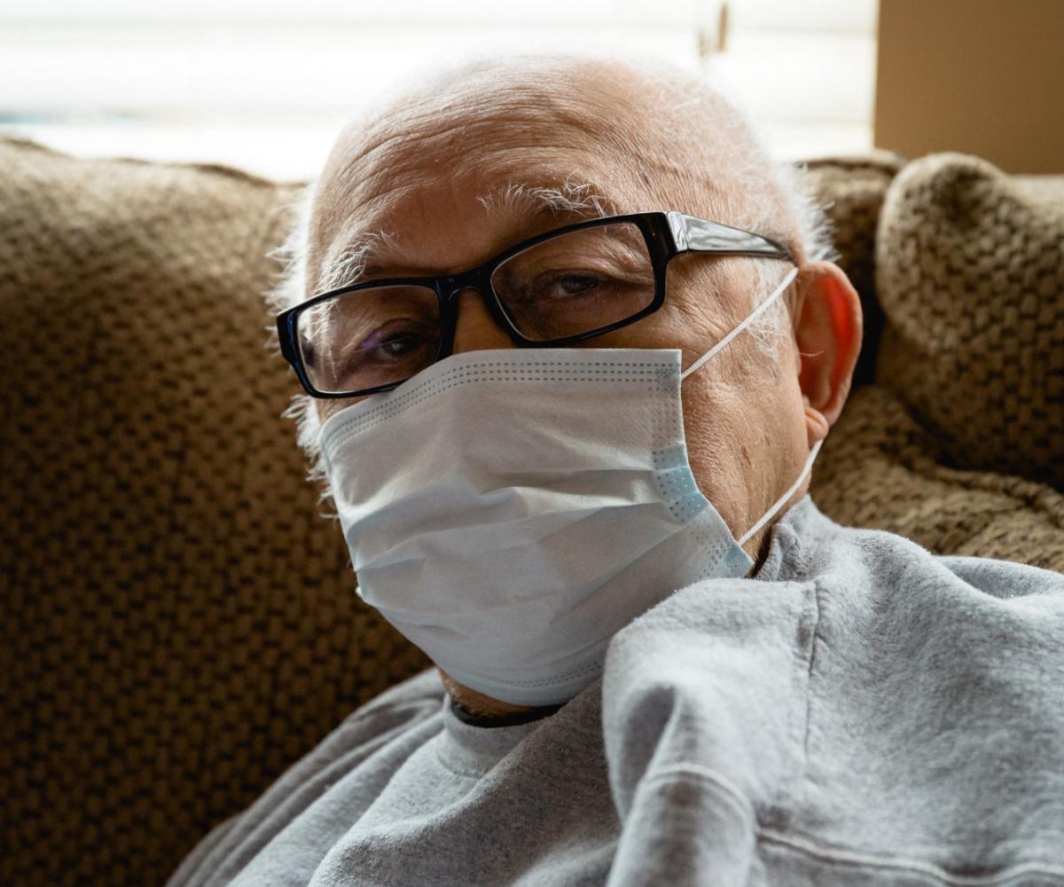 older man wearing mask, photo by Photo by Michael Williams II on Unsplash.