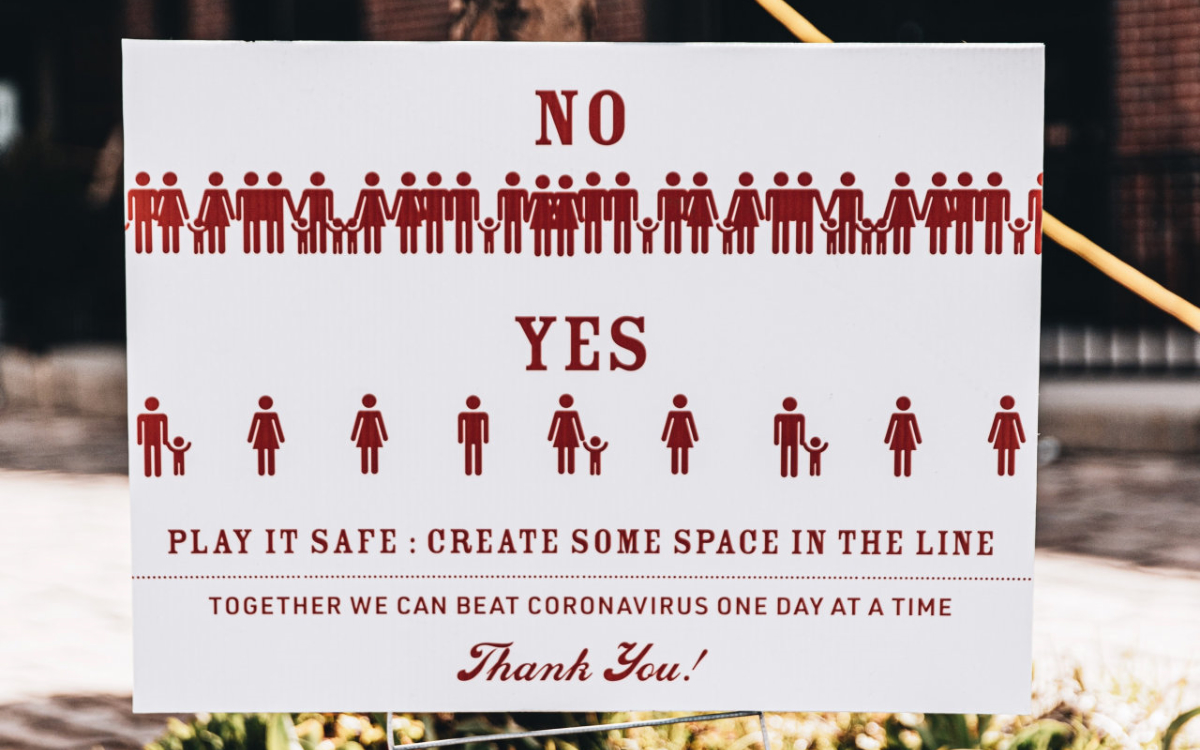 Social distancing sign. Photo by LOGAN WEAVER on Unsplash.