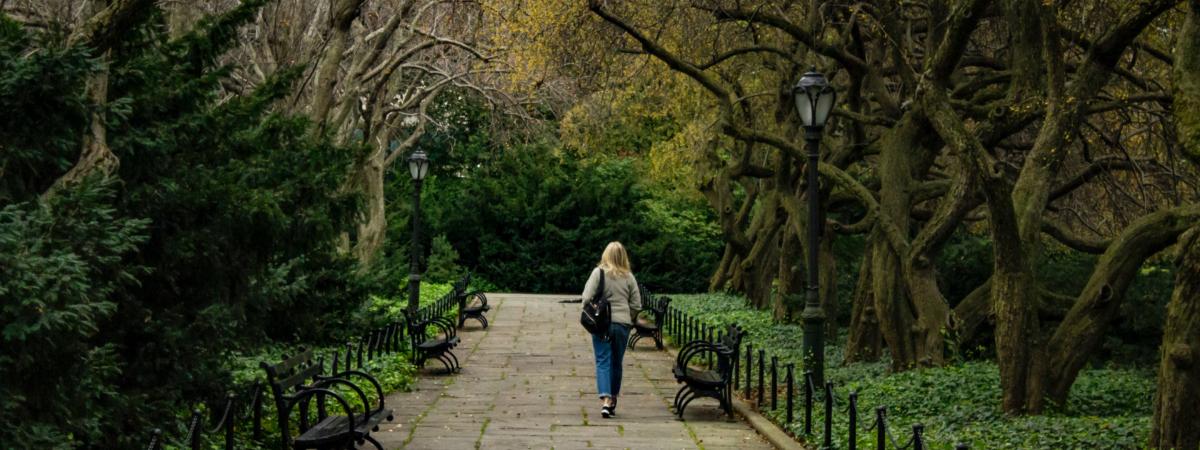 Walking alone in a park. Photo by Gautam Krishnan on Unsplash.