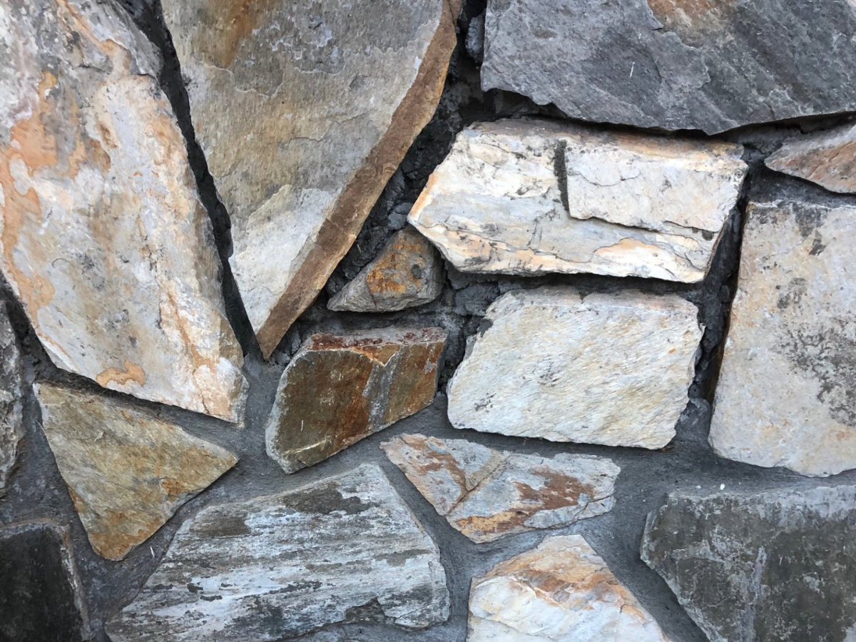 Rock wall with missing grout.